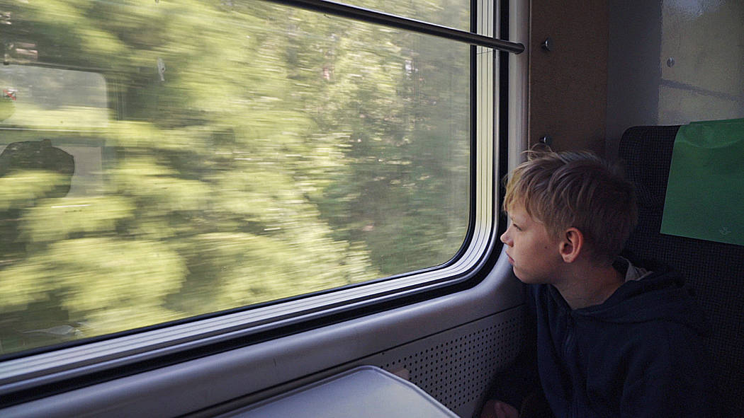 11-year-old Gabriel Bjorstrand looks out of the train window on the first of many trains on a w ...