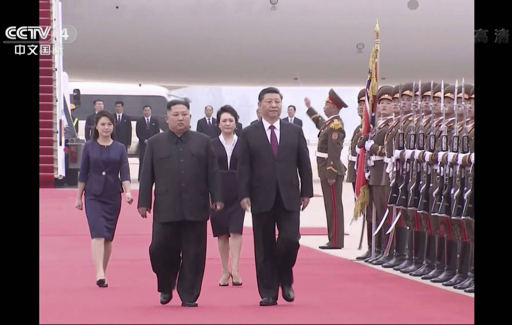 In this image taken from a video footage run by China's CCTV, North Korean leader Kim Jong Un, ...