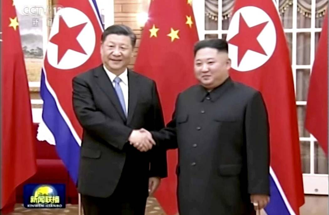 In this image taken from a video footage run by China's CCTV, Chinese President Xi Jinping, lef ...