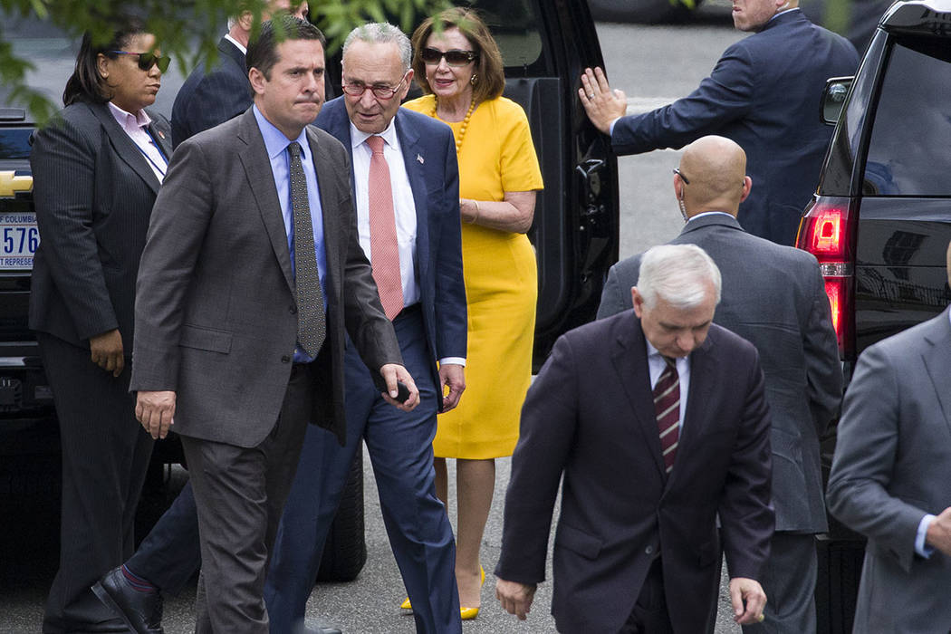 Rep. Devin Nunes, R-Calif., ranking member of the House Intelligence Committee, second from lef ...