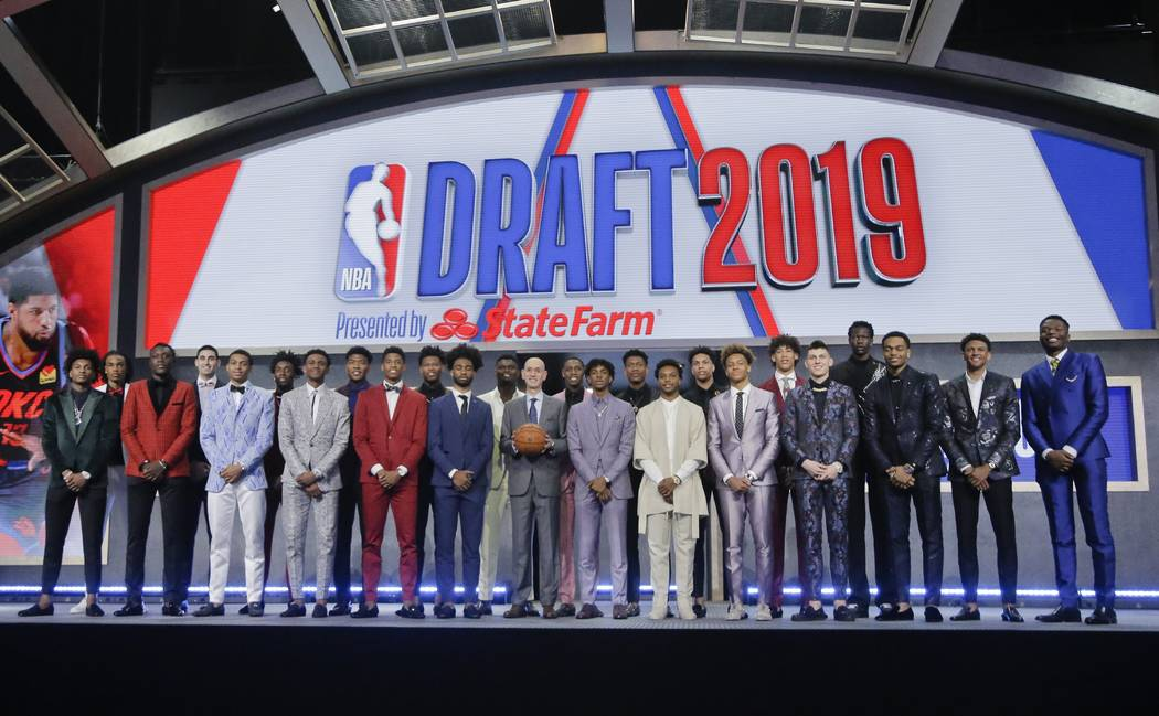 Prospective NBA draft picks pose for a group photo with NBA Commissioner Adam Silver, with bask ...