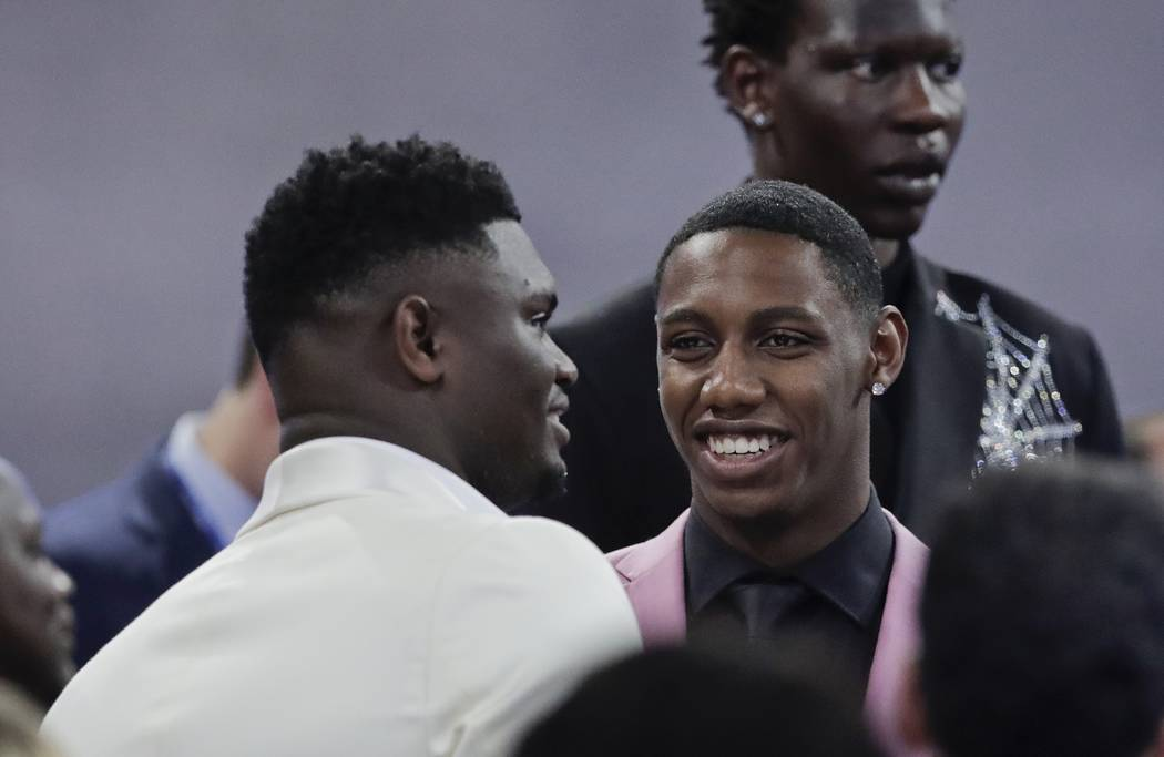Duke's RJ Barrett, center, talks to Zion Williamson, as Oregon's Bol Bol, back, looks elsewhere ...