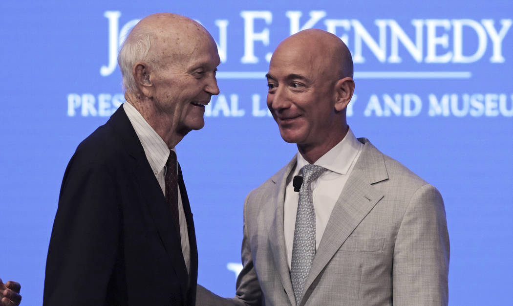 Apollo 11 Astronaut Michael Collins, left, talks with Amazon and Blue Origin founder Jeff Bezos ...