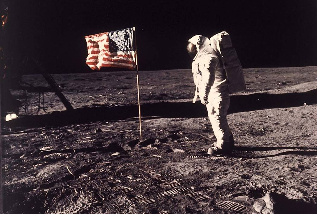 In an image provided by NASA, astronaut Buzz Aldrin poses for a photograph beside the U.S. flag ...