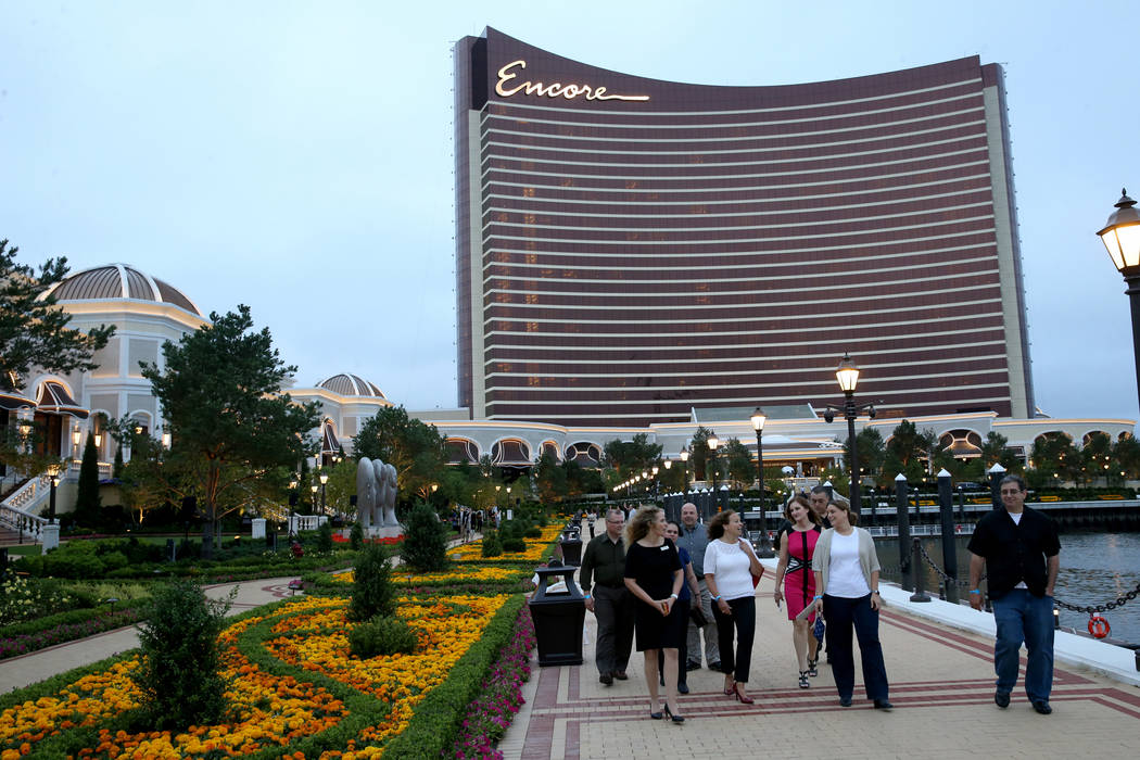Guests take in the Mystic River during an invitation-only party at Encore Boston Harbor Thursda ...