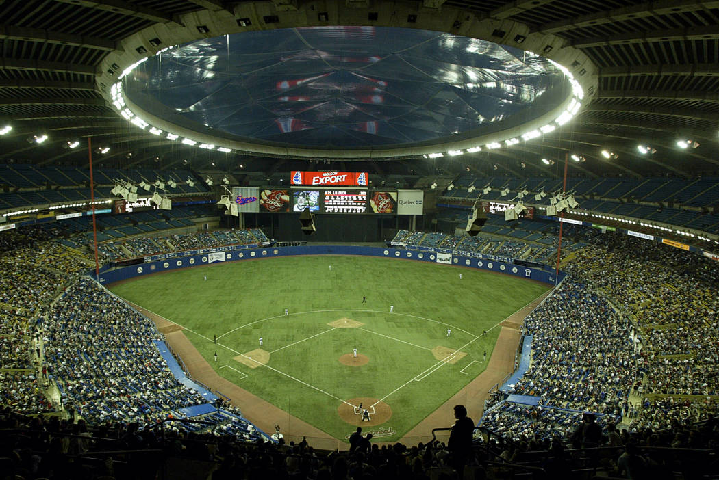 In this Sept. 29, 2004, file photo, fans watch a baseball game between the Montreal Expos and F ...