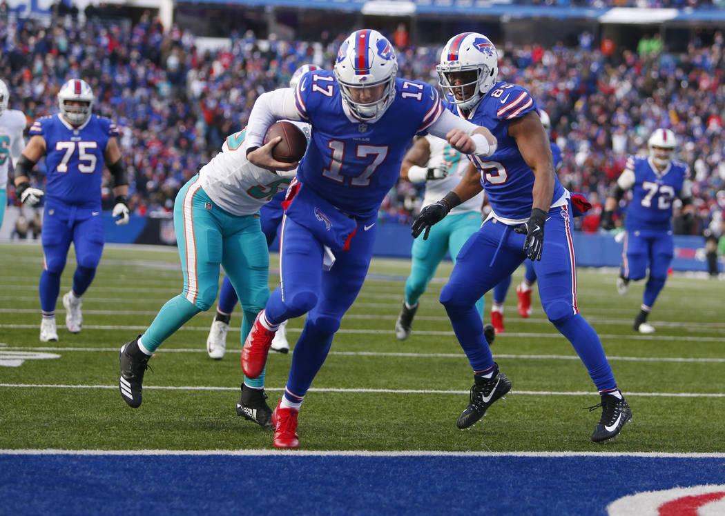 Buffalo Bills quarterback Josh Allen (17) scores a touchdown during the second half of an NFL f ...