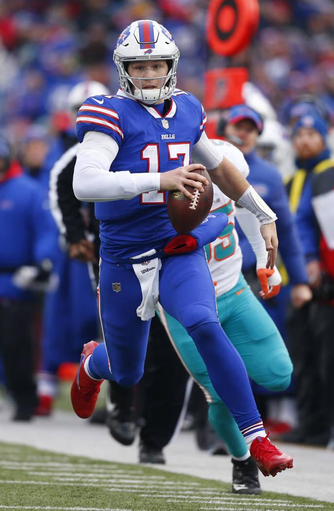 Buffalo Bills Josh Allen (17) carries the Ball during the second half of an NFL football game a ...