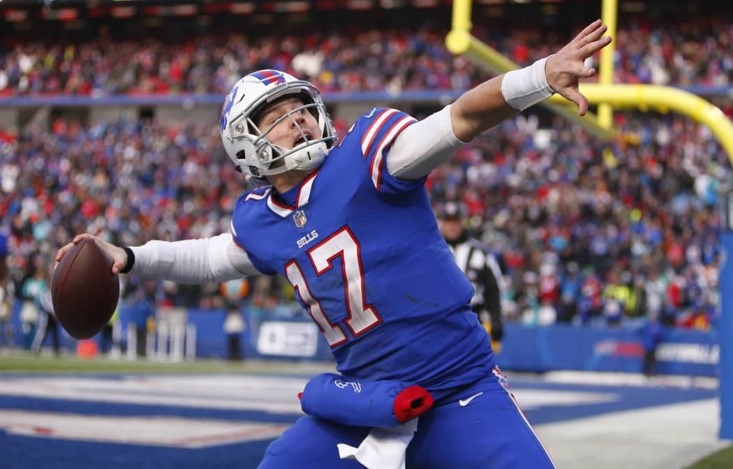 FILE - In this Dec. 30, 2018, file photo, Buffalo Bills quarterback Josh Allen celebrates his t ...