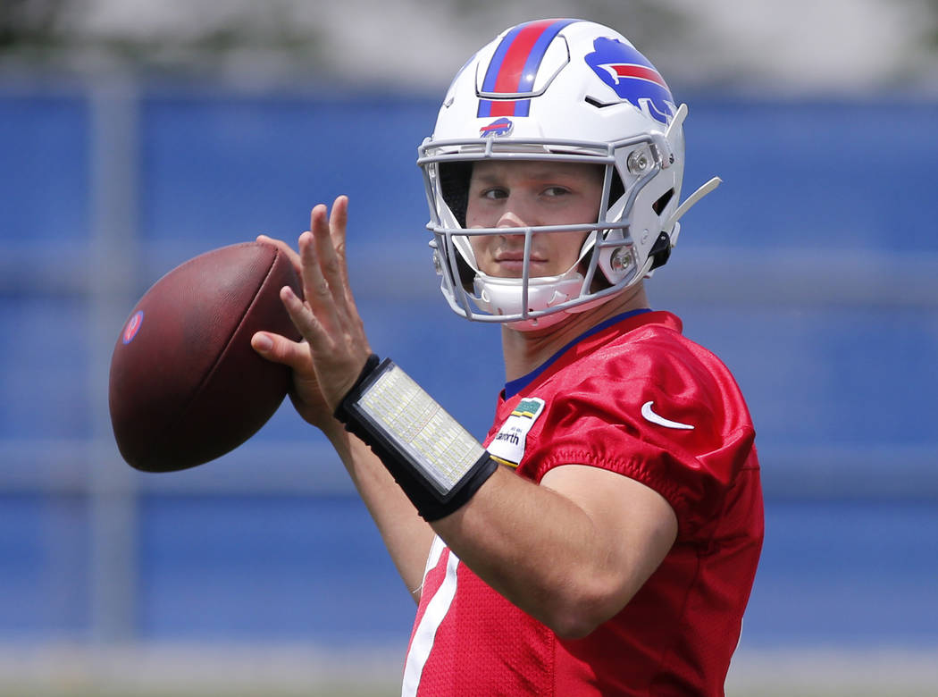 Buffalo Bills quarterback Josh Allen (17) looks to throw the ball during an NFL football team p ...