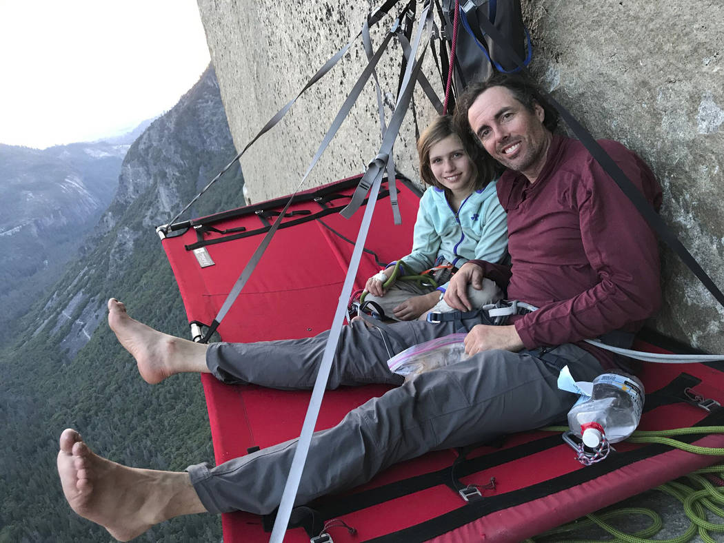 In this June 11, 2019, photo, is Michael Schneiter posing with his daughter, Selah Schneiter, d ...