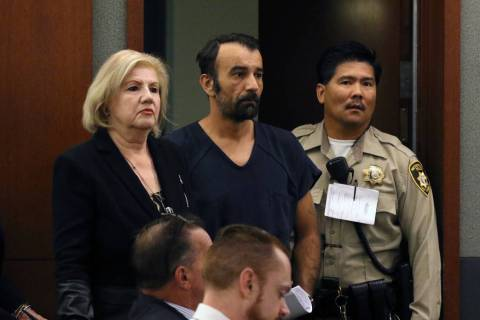 Slobodan Miljus, center, accused of killing his wife with baseball bat, appears in court at the ...