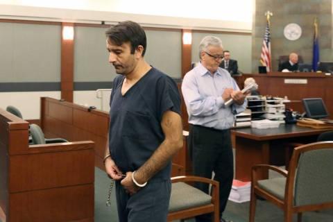 Slobodan Miljus, 37, left, accused of using a baseball bat to kill his wife of 17 years, leaves ...