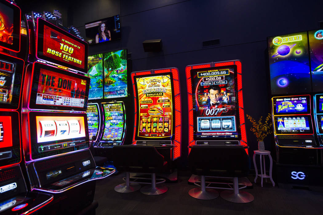 "Slot cabinets with a curved 75"" display and 4K resolution at the Scientific Games showroom ..."
