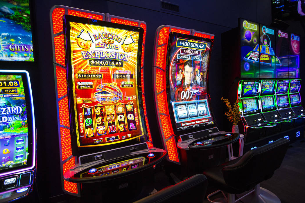 "TwinStar slot cabinets with a curved 75"" display and 4K resolution at the  Scientific Games … 