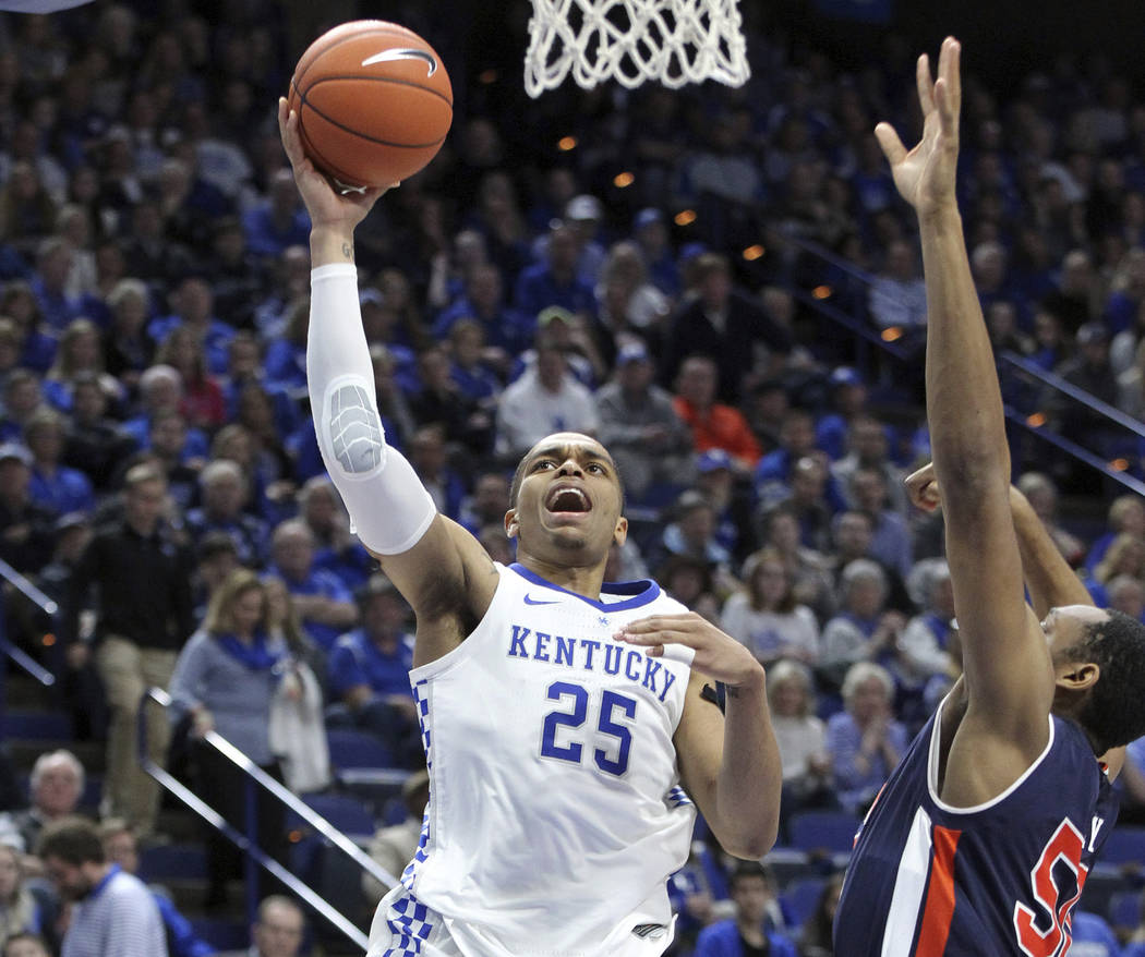 Kentucky's PJ Washington (25) shoots past Auburn's Austin Wiley during the second half of an NC ...