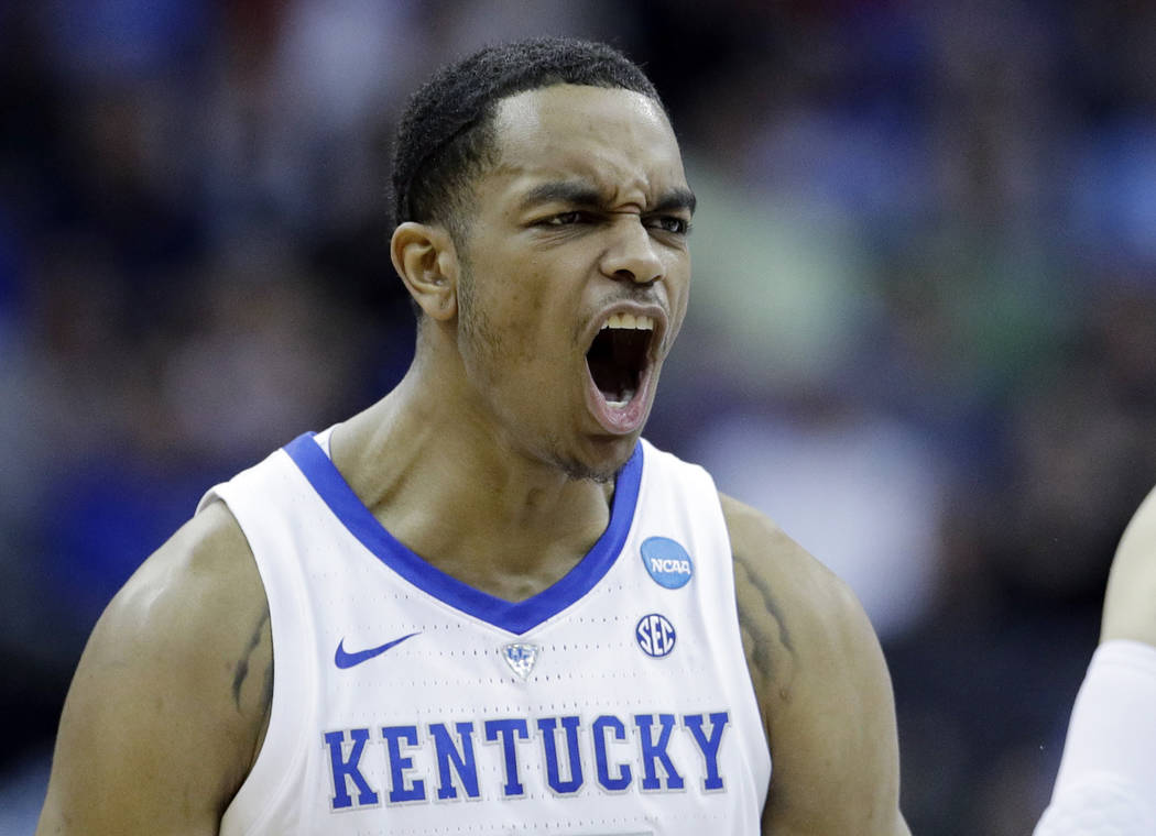 Kentucky's PJ Washington celebrates during the first half of a men's NCAA tournament college ba ...