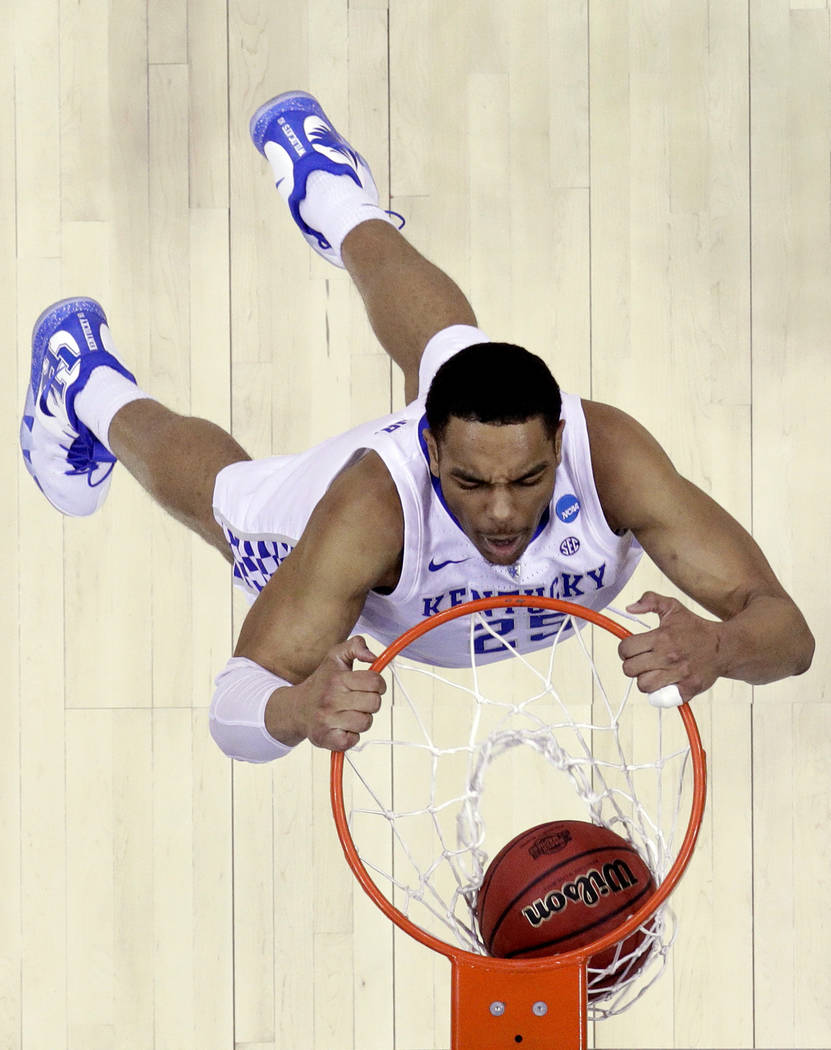 FILE - In this March 31, 2019, file photo, Kentucky's PJ Washington dunks the ball during the s ...