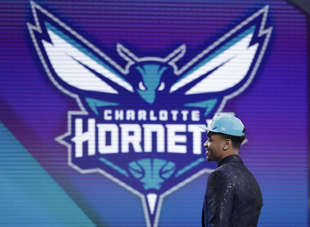 Kentucky's PJ Washington walks on stage after the Charlotte Hornets selected him as the 12th ov ...