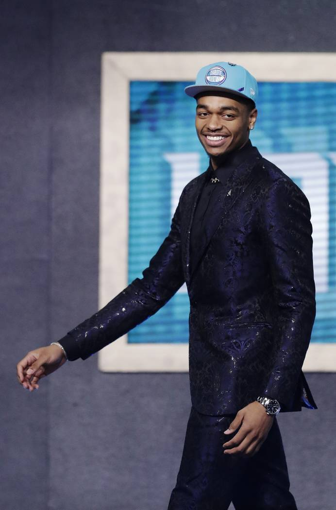 Kentucky's PJ Washington smiles after the Charlotte Hornets selected him as the 12th pick overa ...