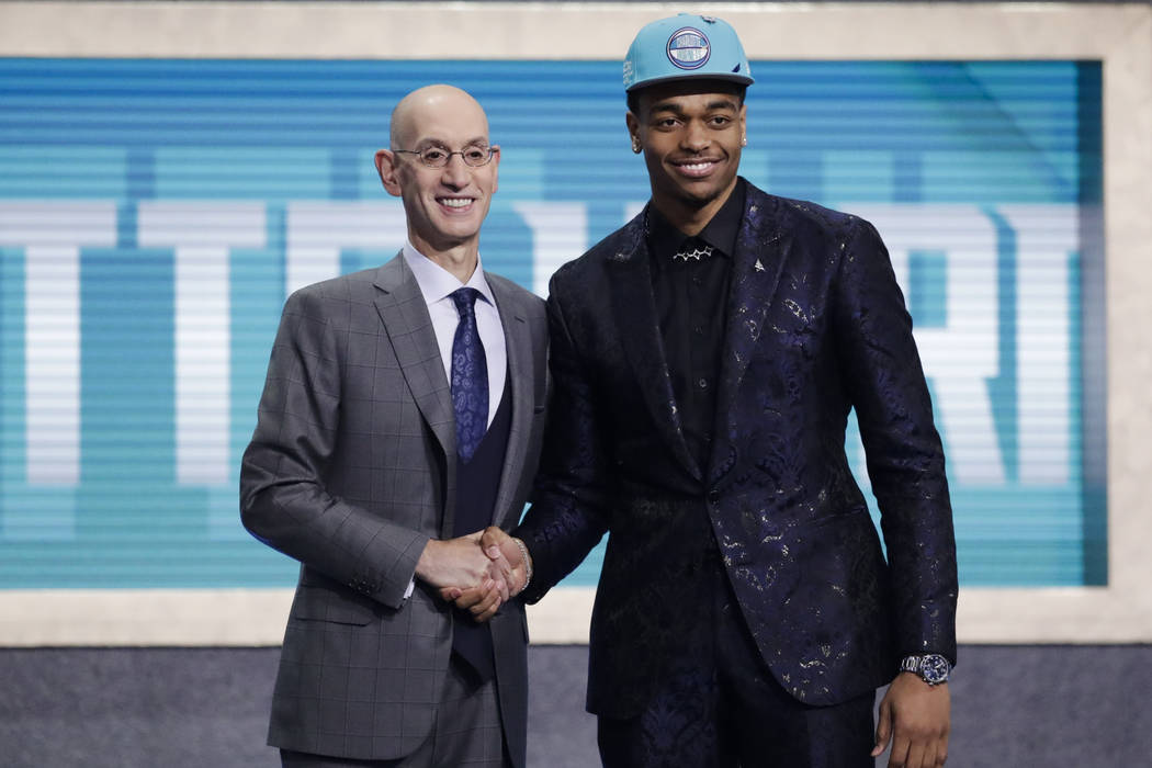 NBA Commissioner Adam Silver, left, poses for photographs with Kentucky's PJ Washington, after ...