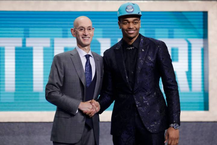 NBA Commissioner Adam Silver, left, poses for photographs with Kentucky's P.J. Washington, aft ...
