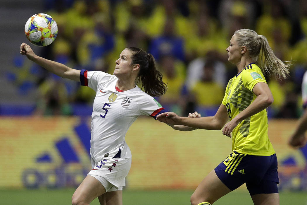 United States' Kelley O Hara looks to kick the ball clear of Sweden's Fridolina Rolfo, right, d ...