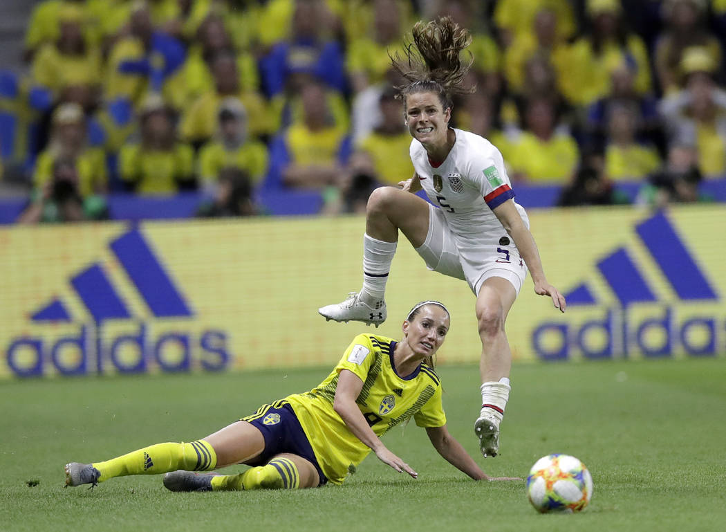 United States' Kelley O Hara leaps over Sweden's Kosovare Asllani during the Women's World Cup ...
