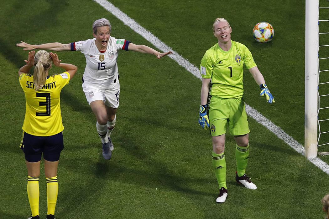 United States' Megan Rapinoe, centre, celebrates after United States' Tobin Heath scored her si ...