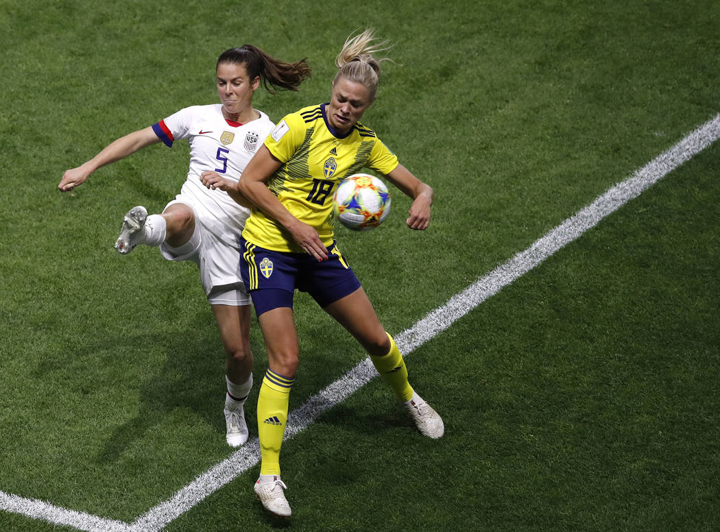 United States' Kelley O Hara, left, and Sweden's Fridolina Rolfo challenge for the ball during ...