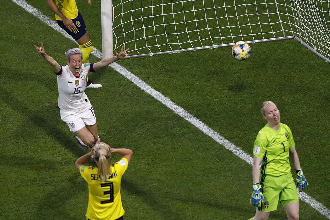 United States' Megan Rapinoe, left, celebrates after United States' Tobin Heath scored her side ...
