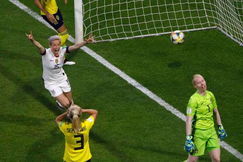 United States' Megan Rapinoe, left, celebrates after United States' Tobin Heath scored her side ...