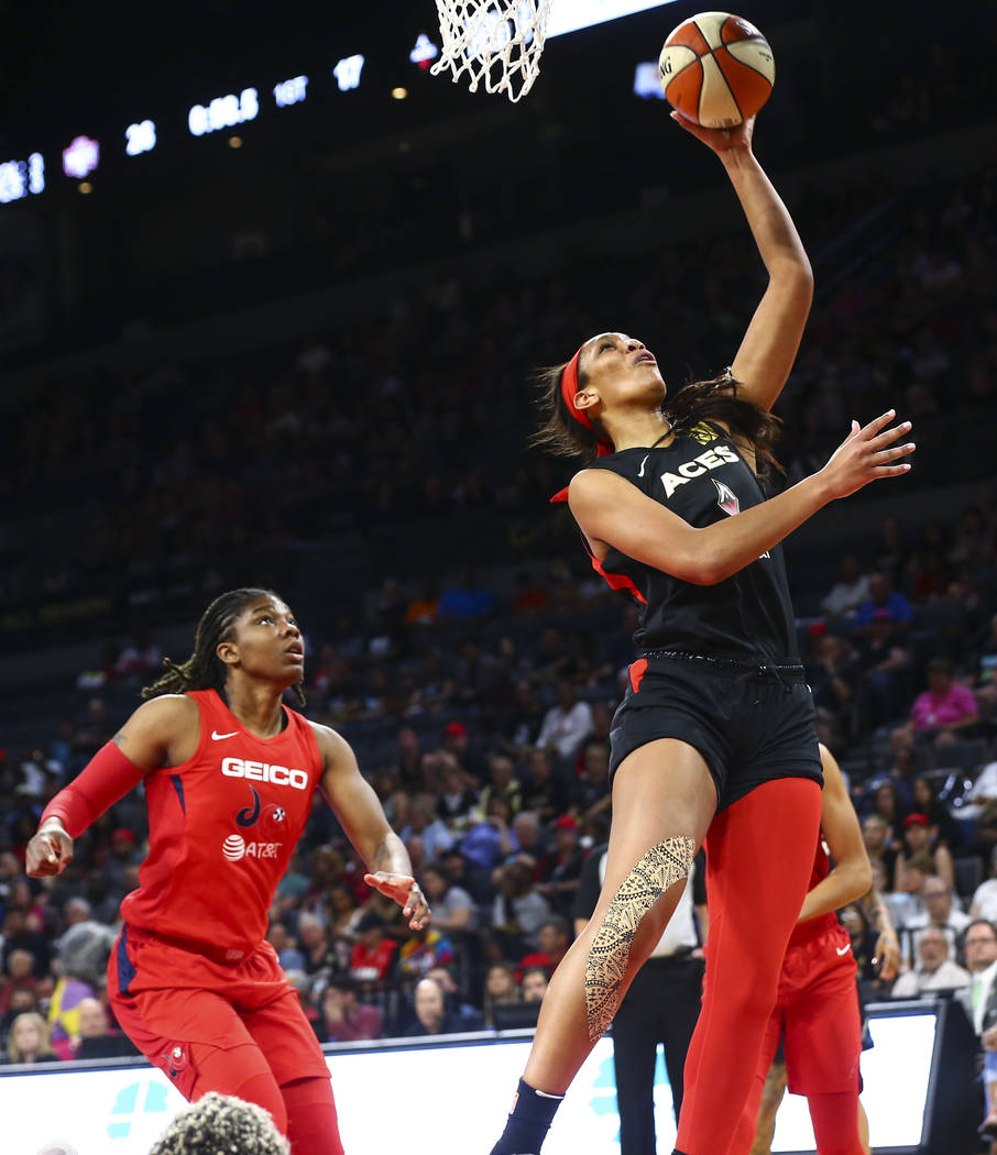 Las Vegas Aces center A'ja Wilson (22) goes to the basket past a Washington Mystics player duri ...
