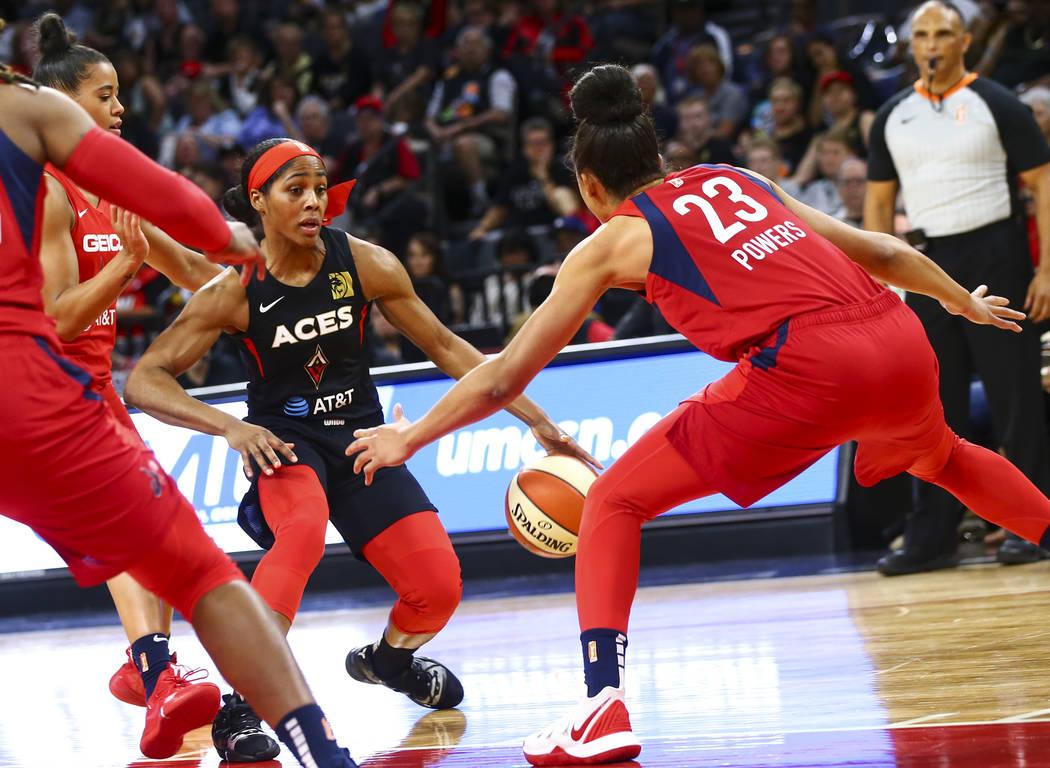 Las Vegas Aces guard Sydney Colson (51) moves the ball around Washington Mystics forward Aerial ...