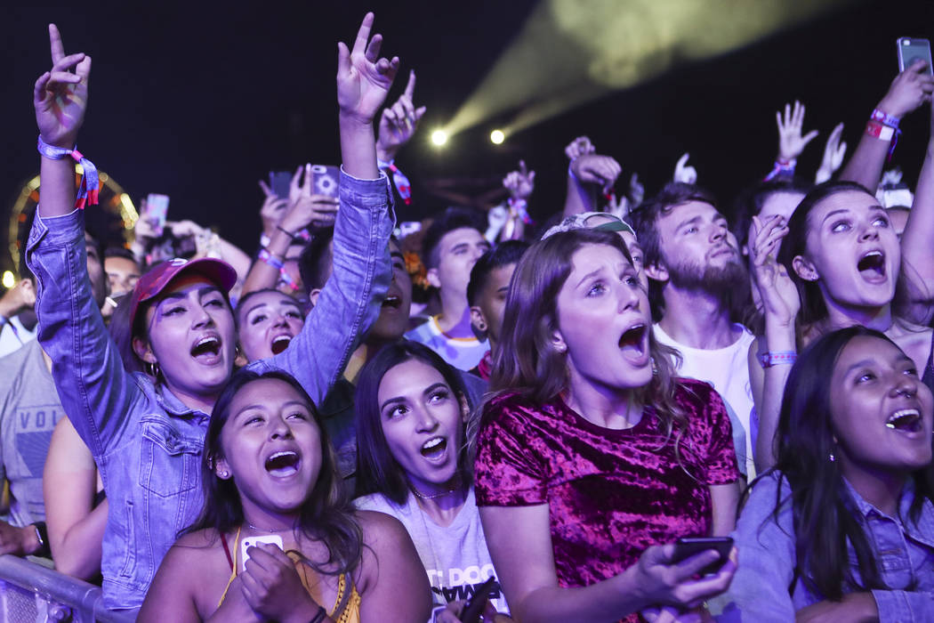 Fans react as Chance the Rapper performs on the first day of the Life is Beautiful festival in ...