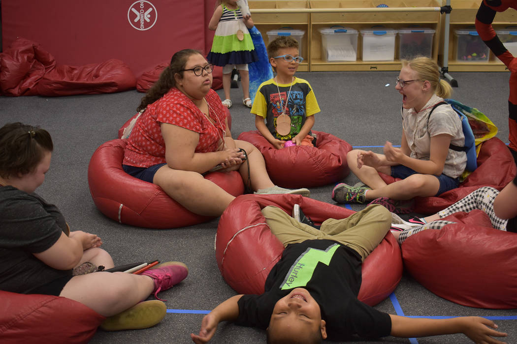 The children in the Nevada Blind Children's Foundation Discovery Day Camp play hot potato on be ...