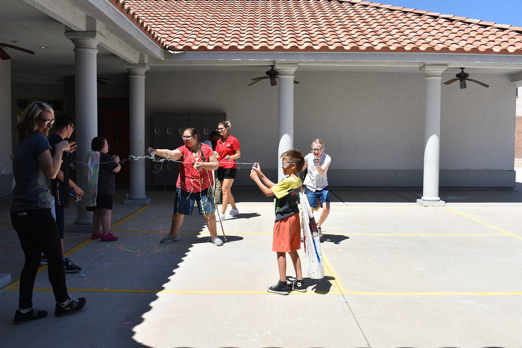 Campers have a silly string war at the Nevada Blind Children's Foundation Discovery Day Camp on ...