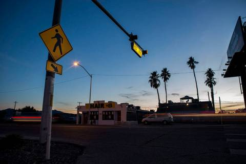 Cars drive by a crosswalk at the intersection of Whitney Avenue and Boulder Highway in Las Vega ...