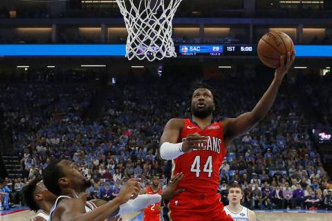 In this April 7, 2019 photo, New Orleans Pelicans forward Solomon Hill, right, goes to the bask ...
