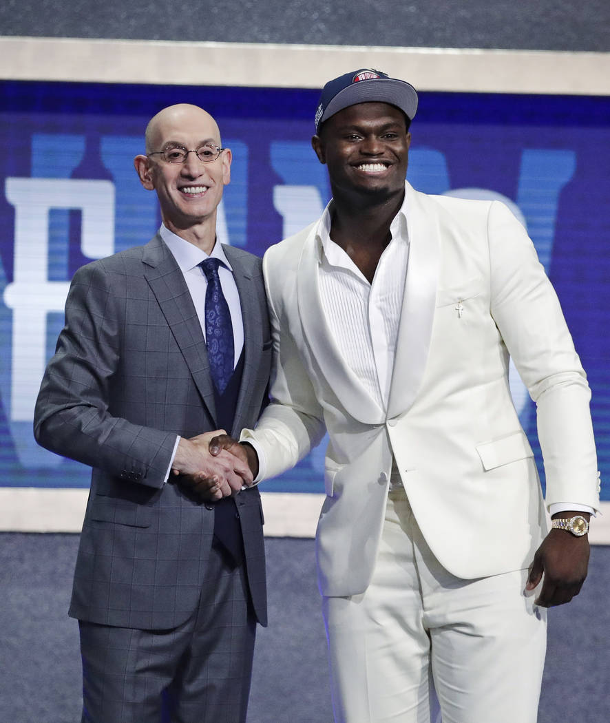 DUke's Zion Williamson, right, poses for photographs with NBA Commissioner Adam Silver after be ...