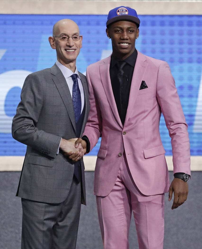 Duke's RJ Barrett poses for photographs with NBA Commissioner Adam Silver after being selected ...