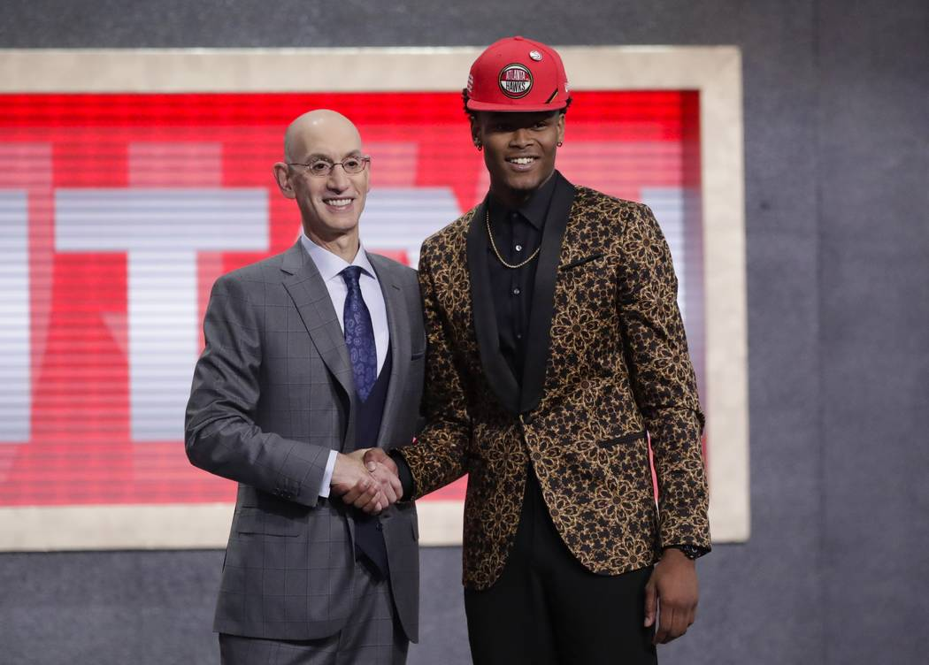 NBA Commissioner Adam Silver poses for photographs with Duke's Cam Reddish after the Atlanta Ha ...
