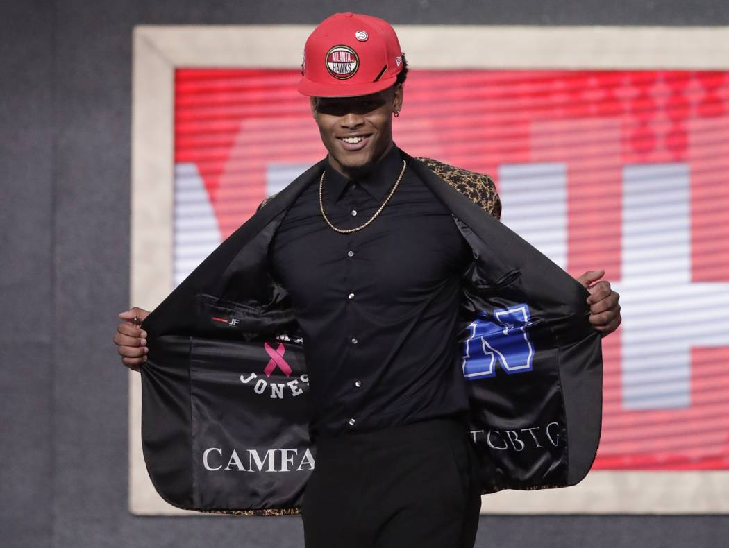 Duke's Cam Reddish shows off his jacket after the Atlanta Hawks selected him as the 10th overal ...