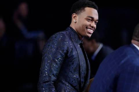 Kentucky's PJ Washington reacts after the Charlotte Hornets selected him as the 12th pick overa ...