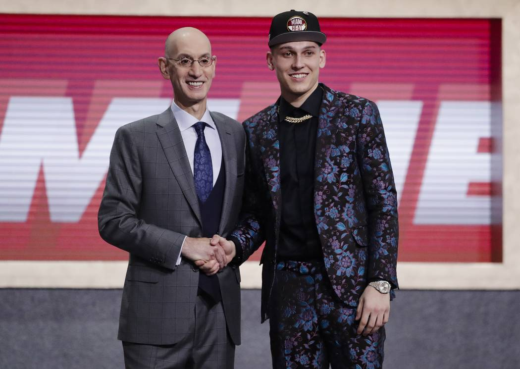NBA Commissioner Adam Silver, left, poses for photographs with Kentucky's Tyler Herro after the ...
