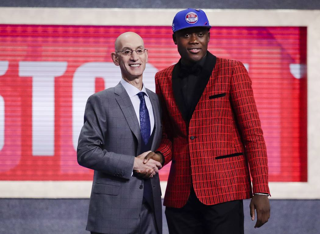 NBA Commissioner Adam Silver, left, poses for photographs with Sekou Doumbouya, of France, afte ...