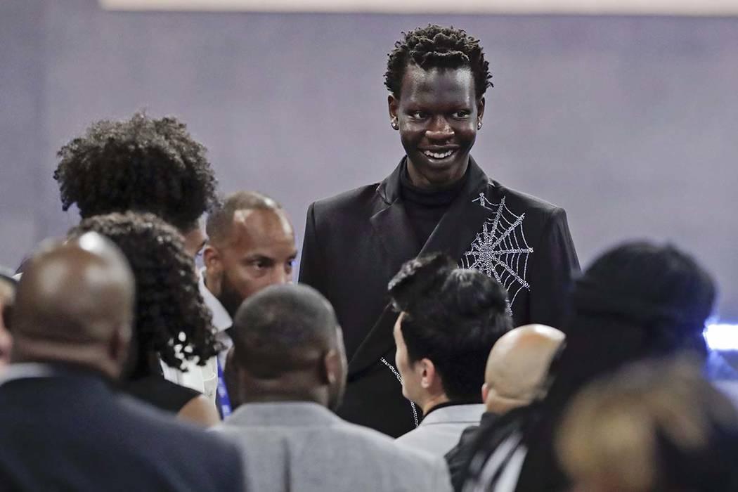 Oregon's Bol Bol smiles before the NBA draft Thursday, June 20, 2019, in New York. (AP Photo/Ju ...