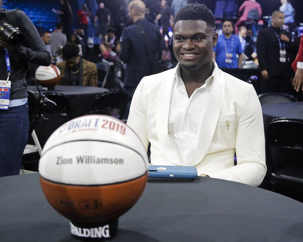 Zion Williamson, of Duke, smiles before the NBA basketball draft Thursday, June 20, 2019, in Ne ...