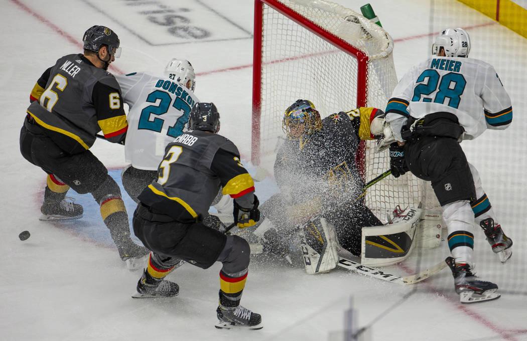 Golden Knights goaltender Marc-Andre Fleury (29) is covered in ice shavings fromSan Jose Sharks ...