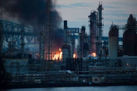 Flames and smoke emerge from the Philadelphia Energy Solutions Refining Complex in Philadelphia ...